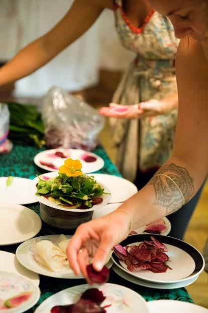 Hannah plating a locally sourced and 100% sustainable radicchio salad for a private Farm to Table catered event
